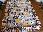 Fleece dog blanket medium size dog faces.